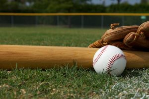 Baseball Bat and Glove on the grass with room for copy